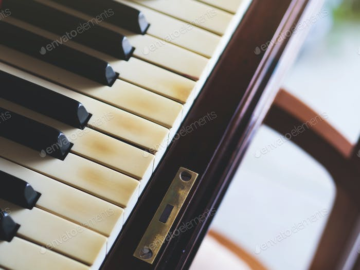 Old piano keys closeup
