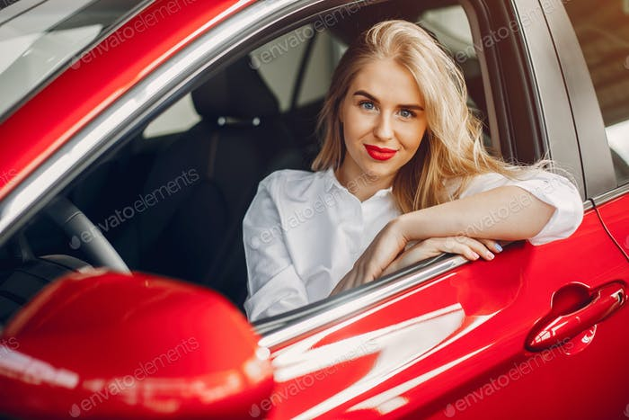 Stylish woman in a car salon