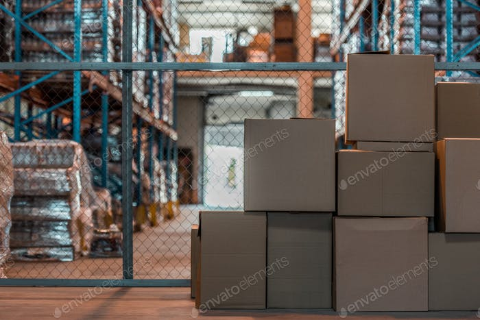 cardboard boxes in modern storehouse interior