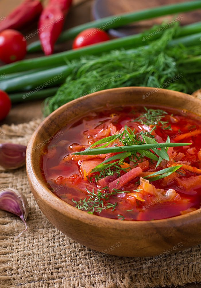 Traditional Ukrainian Russian vegetable borscht on the old wooden background