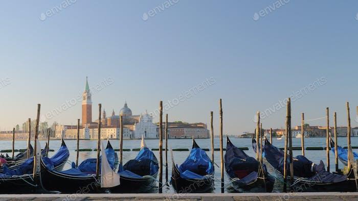 Many gondola boats in Venice Italy