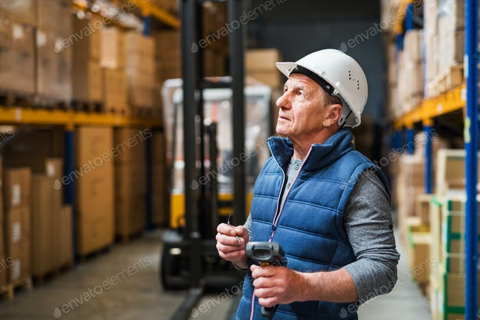 Portrait of a senior male warehouse worker or a supervisor.