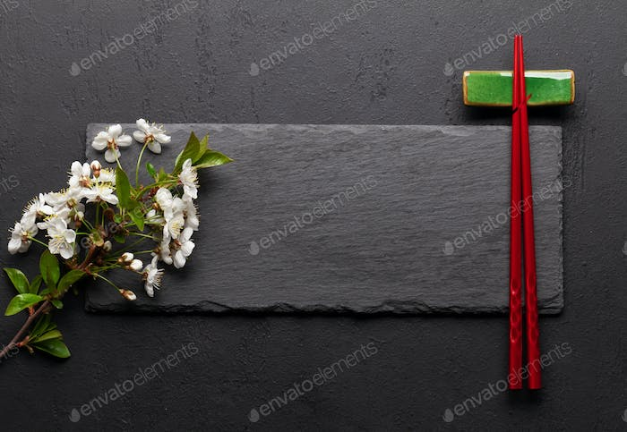 Japanese food with cherry blossom and sushi chopsticks