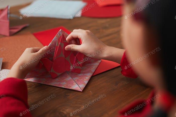 Unrecognizable Girl Making Paper Crane