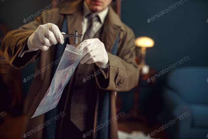 Male detective with tweezers finds sleeve
