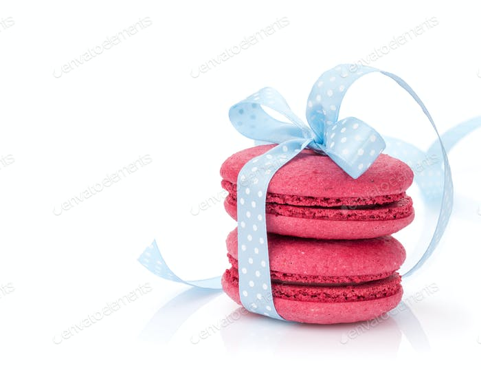 Red macarons with blue ribbon