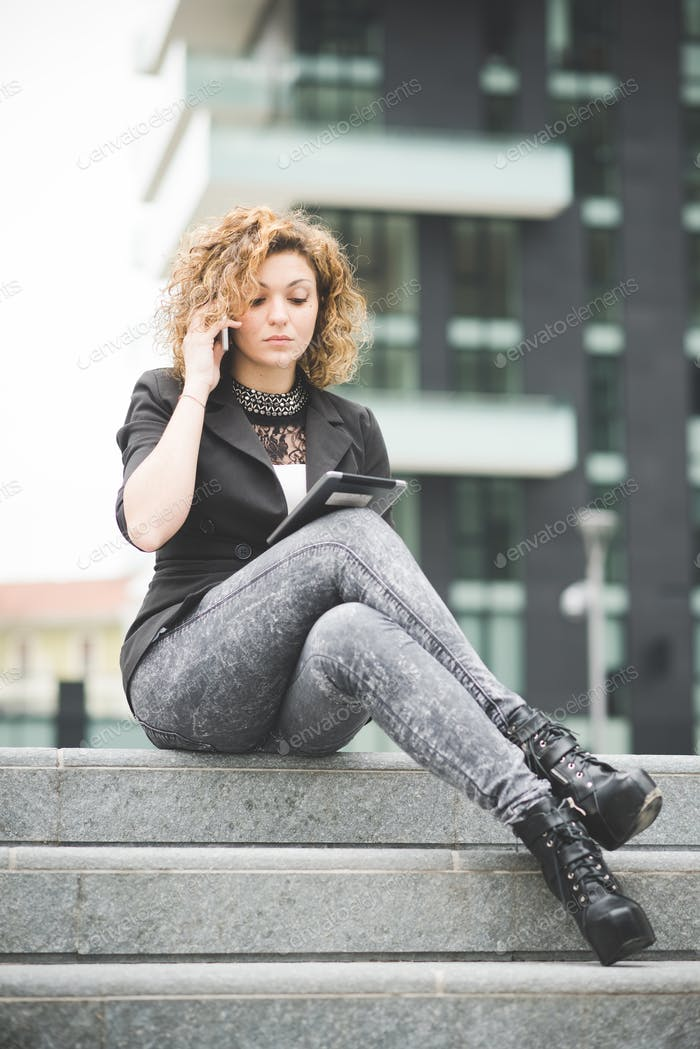 Young beautiful caucasian contemporary businesswoman seated on t