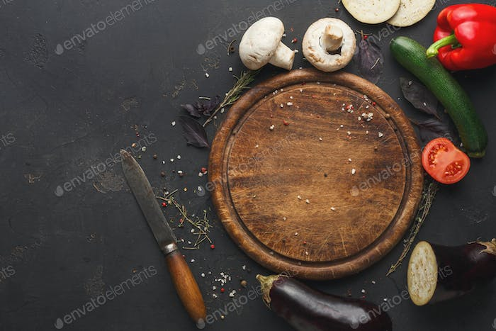Vegetables on a wooden background top view copy space