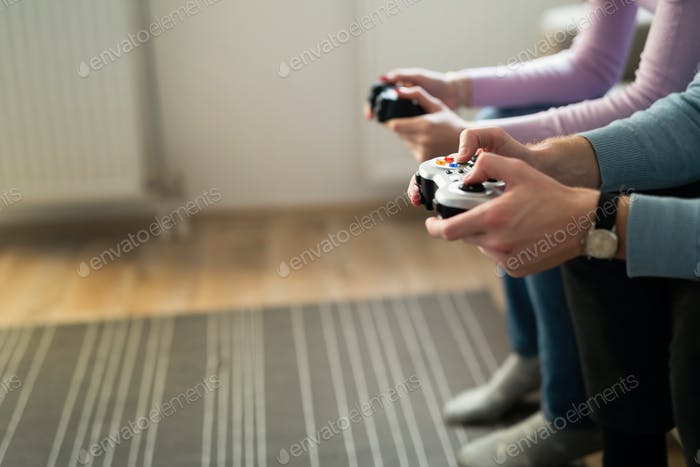 Beautiful couple playing video games on console