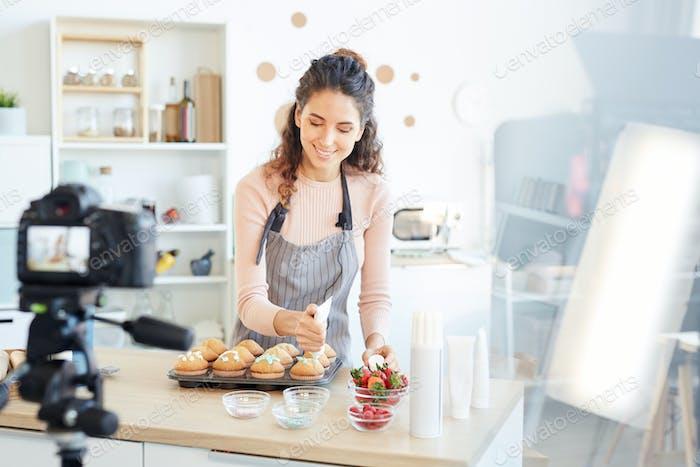 Baker Decorating Cupcakes