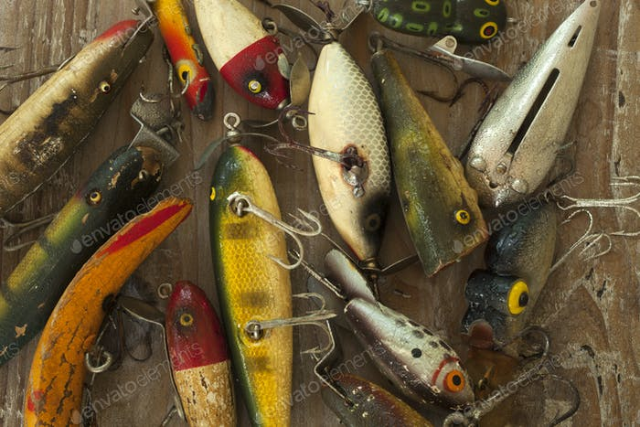Antique Fishing Lures with Water Droplets in a Messy Pile
