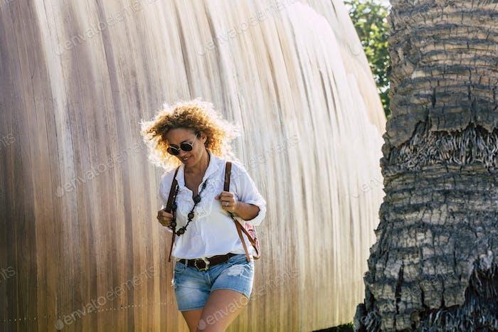 Cheerful beautiful young woman walk outdoor
