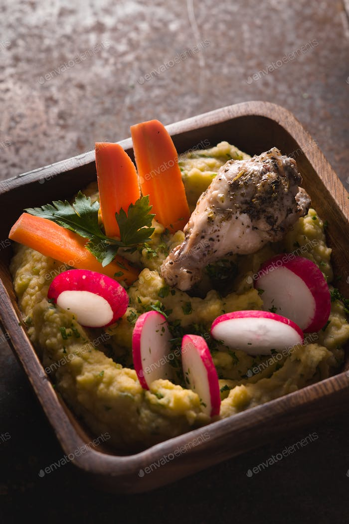 Puree beans, chicken, carrots, radishes in a bowl