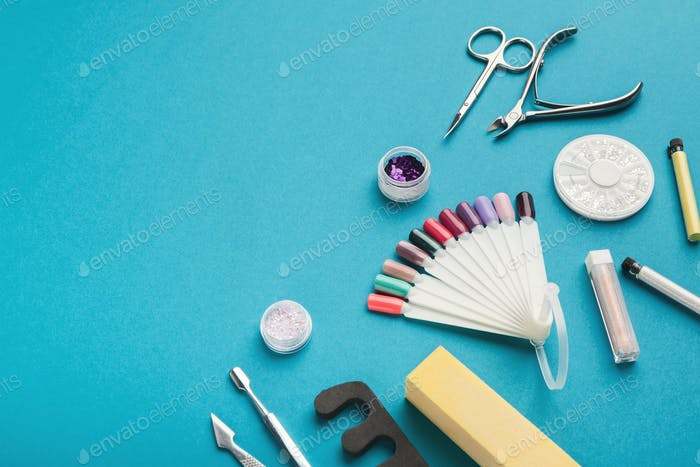Manicure supplies on blue background