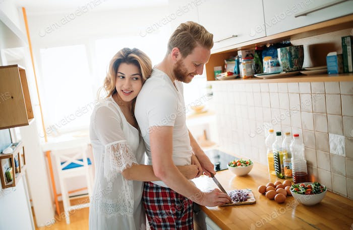 Romantic couple speding time together in kitchen