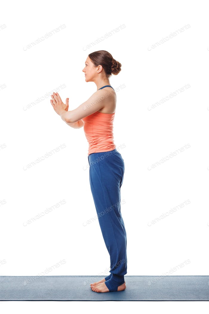 Woman doing yoga asana Tadasana namaste