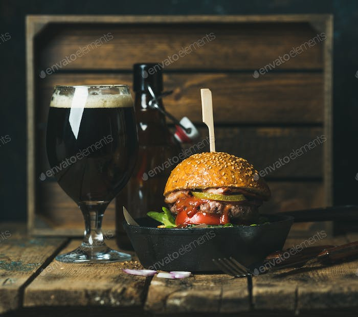 Beef burger with crispy bacon, vegetables and beer