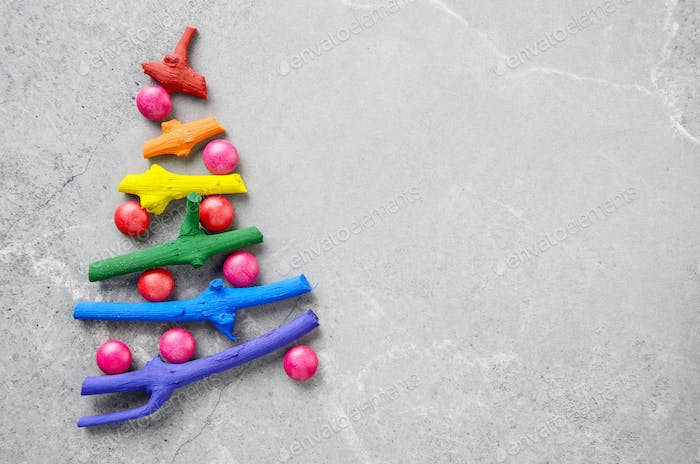 Flat lay stylized Christmas tree made of small twigs painted in