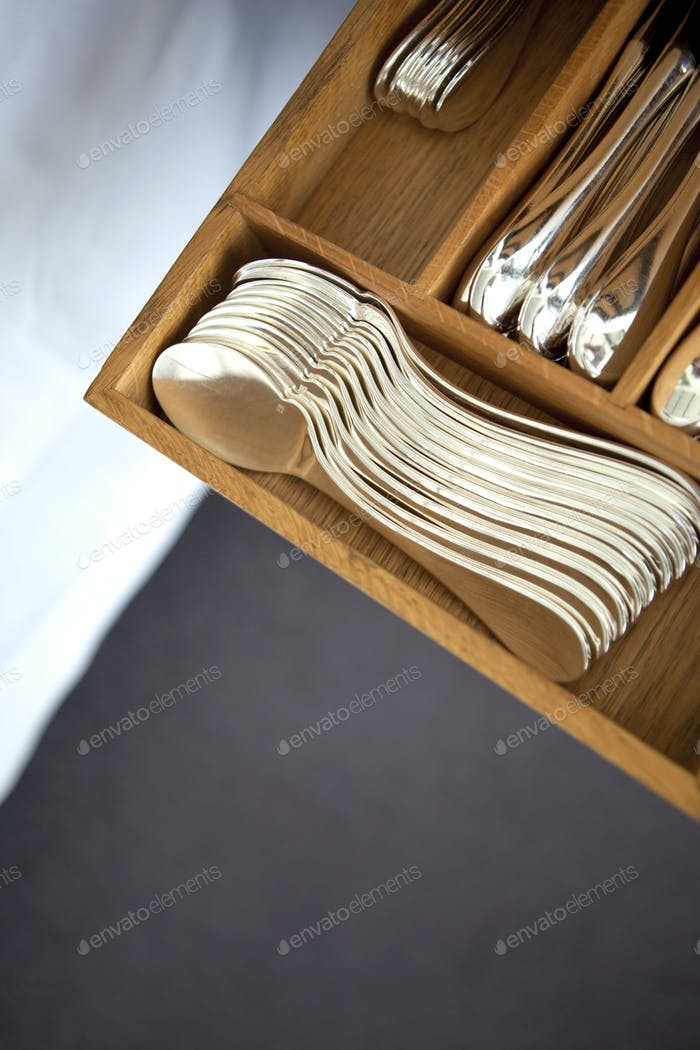 Saucer spoons in a drawer