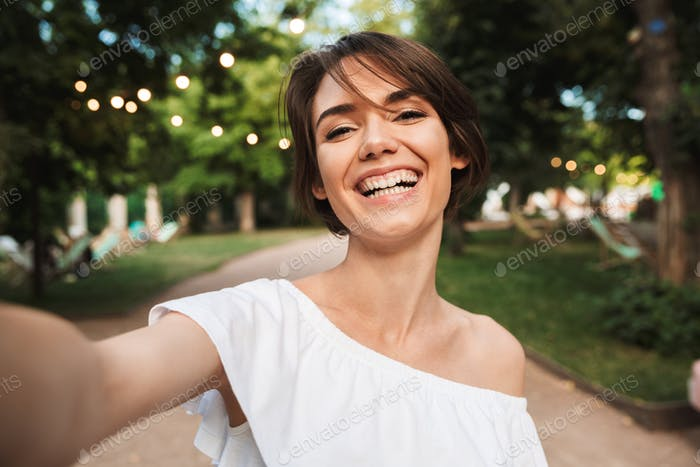 Smiling young girl taking a selfie