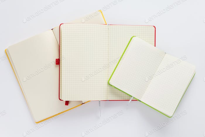 open checked notebook with empty pages