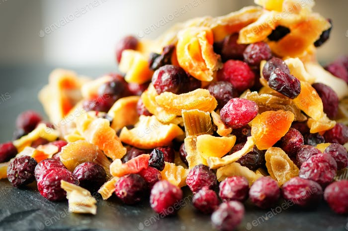 Mix of dried fruits on stone. Cranberry, rhubarb, apple, mango, cherry, peach, apricot. Handmade