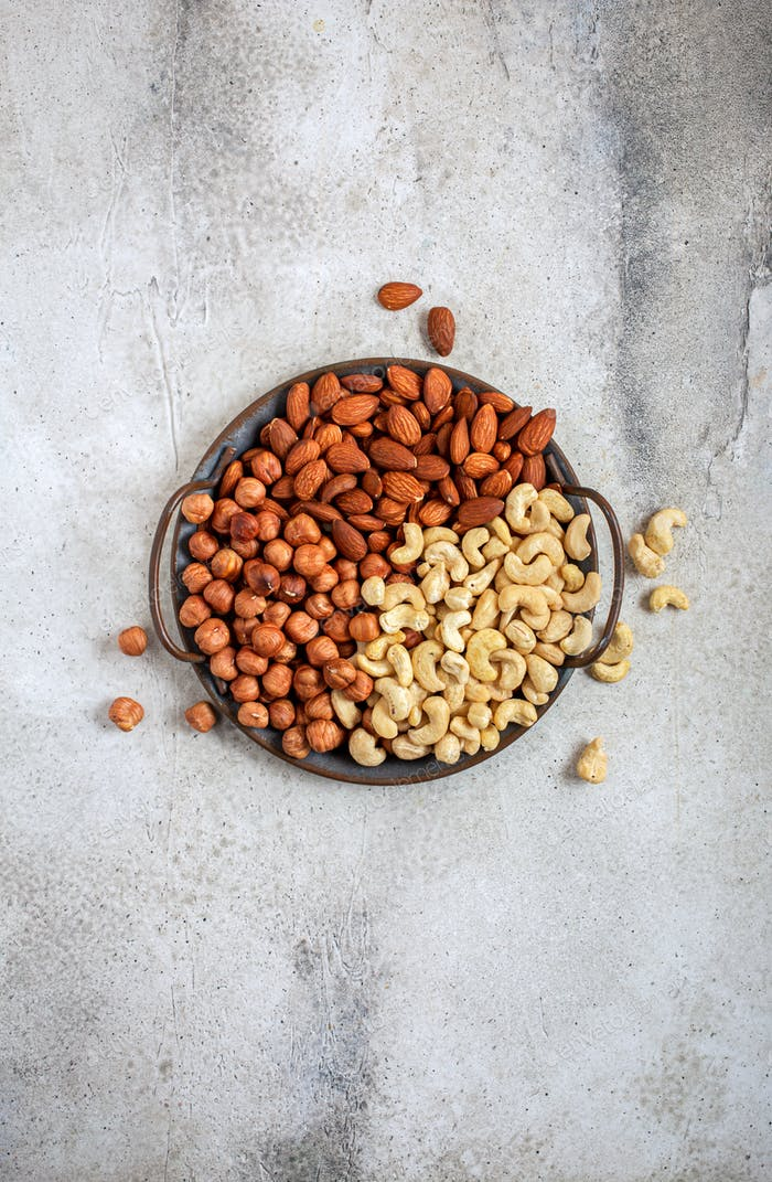 Shelled almonds hazelnuts and cashew on platter
