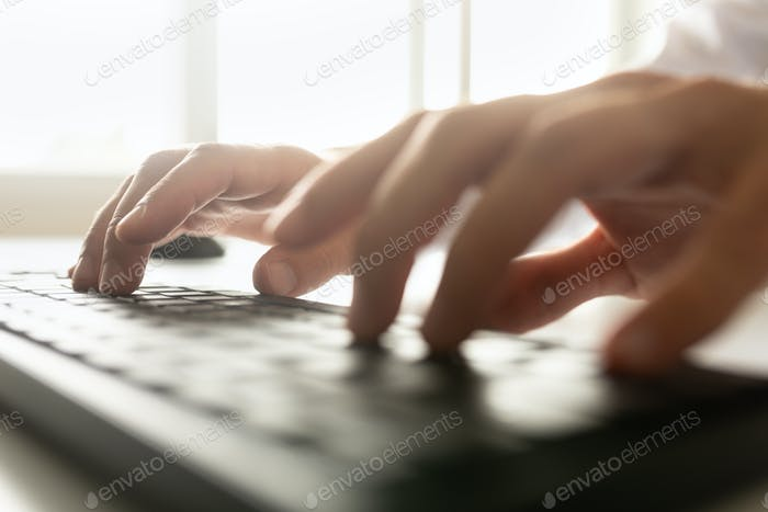 Low angle view of a businessman typing on a computer keyboard