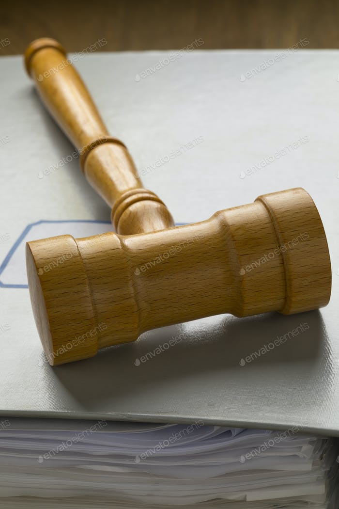 Gavel on a map with papers