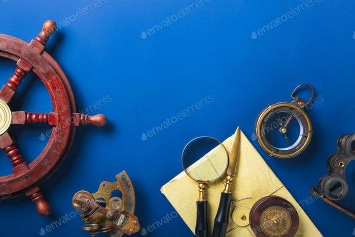 Old fashioned flat lay with retro accessories on blue background