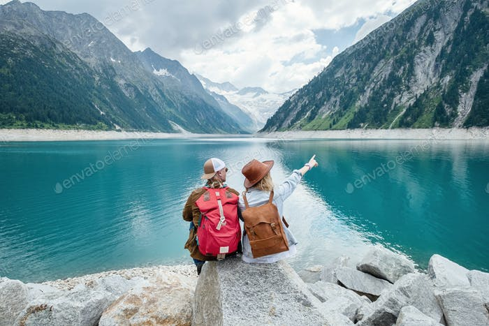A team of travelers looking at the lake in Austria. Travel and tourism