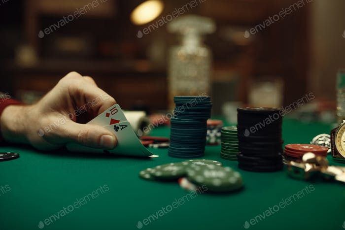 Male player hands with cards, blackjack