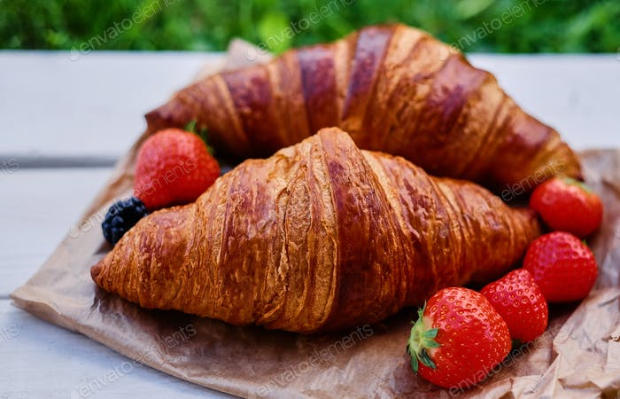 Delicious croissant with strawberry.
