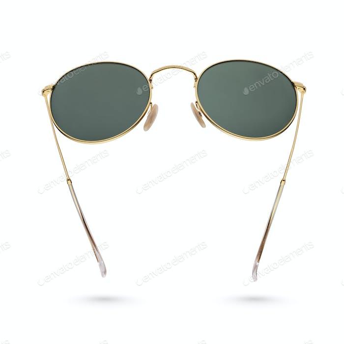 Gold frame round black sunglasses isolated on white.