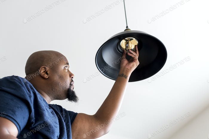 Man changing lightbulb