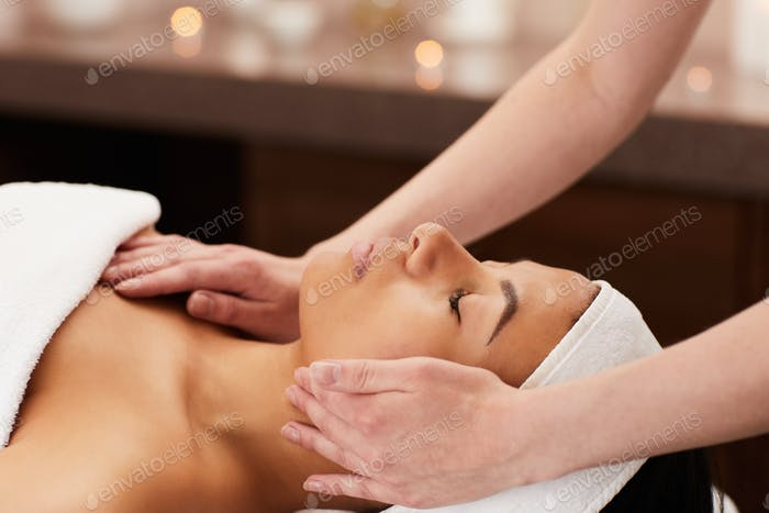 Beautiful Woman Enjoying Face Massage
