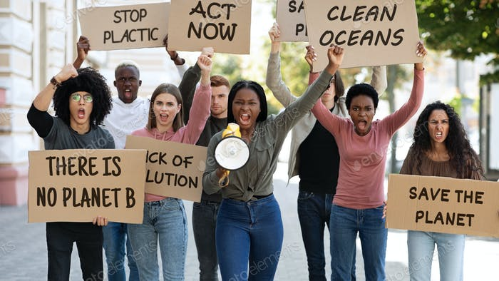 Green peace activists making strike on the street
