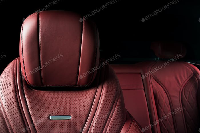 Modern race car  red perforated leather interior.