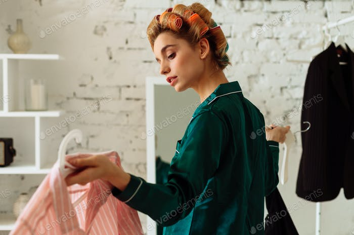 fashionable adult girl in pajamas taking decision for her style