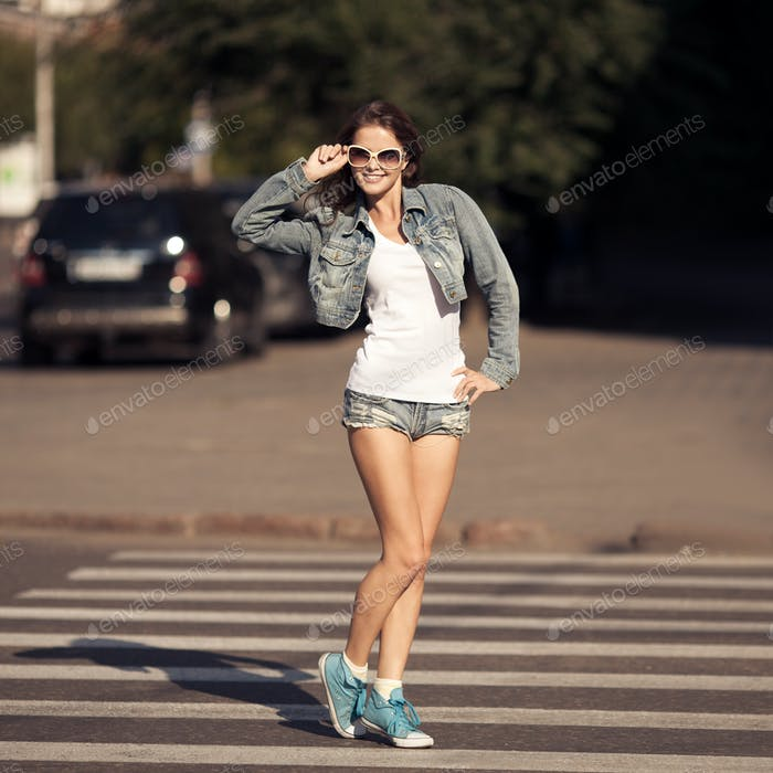Young Woman Walking On City Street