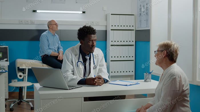 Medic of african american ethnicity doing examination