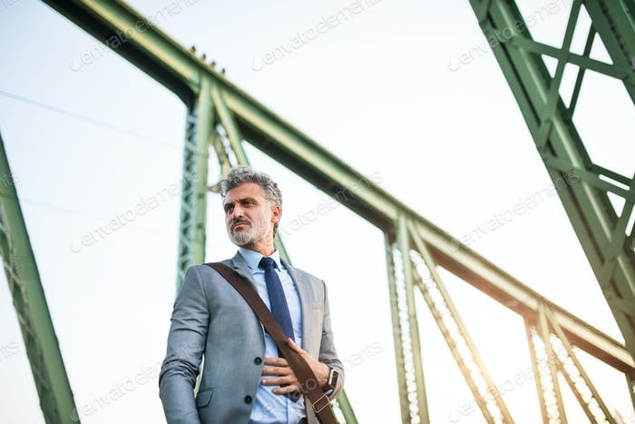 Mature businessman in a city.