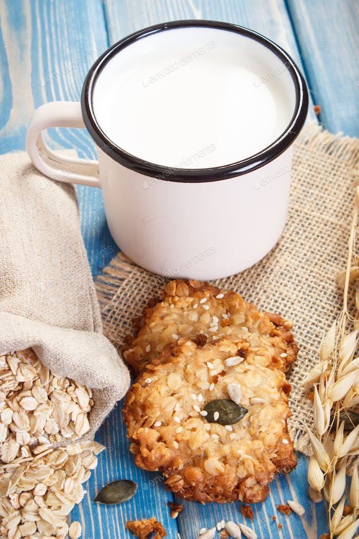 Homemade oatmeal cookies, ingredients for baking and ears of oat, healthy dessert concept