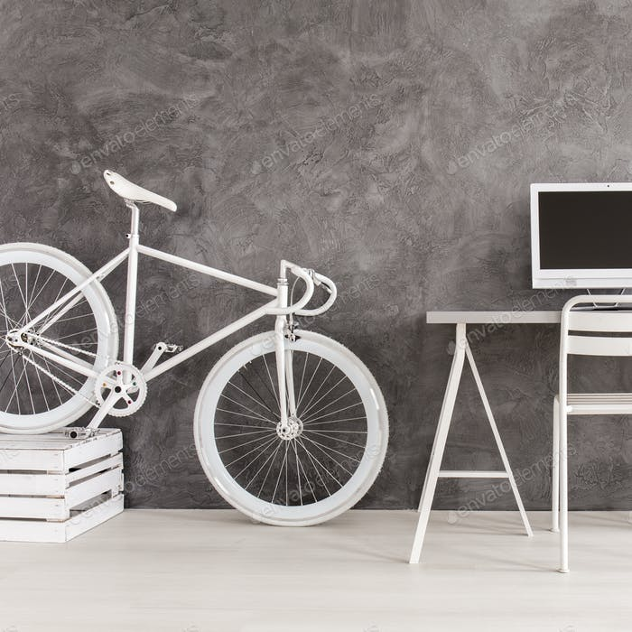 Grey room with bike and desk