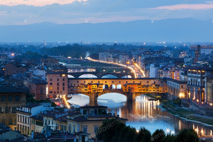 Florence, Italy night skyline. Ponte Vecchio bridge over Arno River.