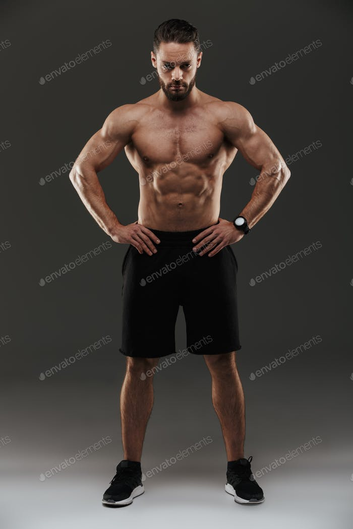 Full length portrait of a confident muscular man posing