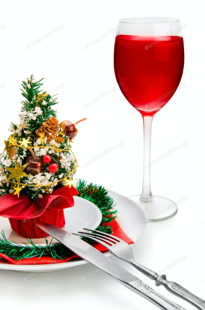 glass of red wine and Christmas decoration, isolated on white ba