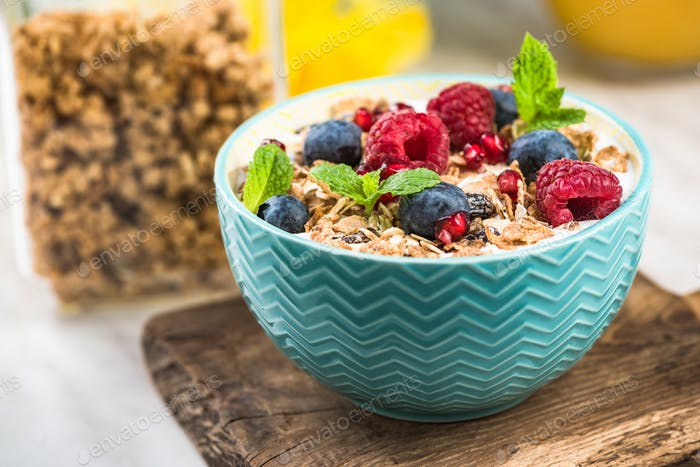Healthy breakfast bowl with cereal and fruits