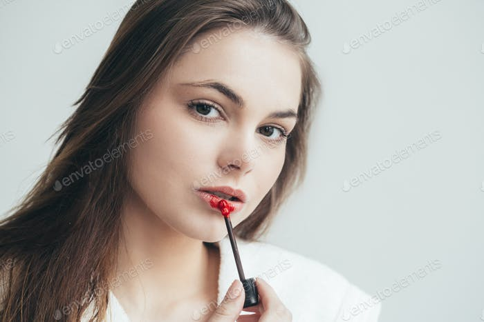 Woman lipstick makeup portrait. Beautiful female with red pink lips.