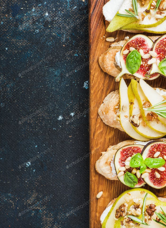 Crostini with pear, ricotta cheese, figs, nuts and fresh herbs
